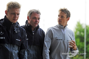 Kevin Magnussen, McLaren, with team mate Jenson Button, McLaren (Right)