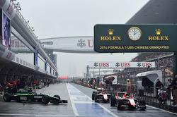 Jules Bianchi, Marussia F1 Team MR03 and Max Chilton, Marussia F1 Team MR03 at the end of the pit lane