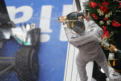 Race winner Lewis Hamilton, Mercedes AMG F1 celebrates on the podium with team mate Nico Rosberg, Mercedes AMG F1