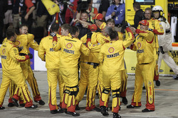The Penske crew celebrates Joey Logano's win