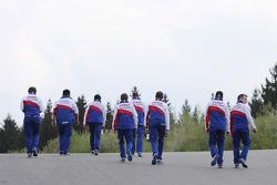 The Toyota team walks the track