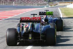 Daniel Ricciardo, Red Bull Racing RB10 running flow-vis paint on the rear wing and Romain Grosjean, Lotus F1 E22