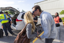 Kurt Busch and girlfriend Patricia Driscoll share a kiss upon arriving in New York City