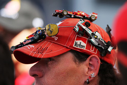 A fan with cars on his cap