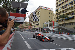 Jules Bianchi, Marussia F1 Team MR03 takes the chequered flag at the end of the race to score the team's first F1 points