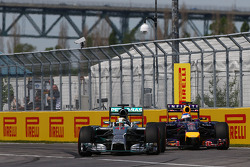 Lewis Hamilton, Mercedes AMG F1 W05 and Sebastian Vettel, Red Bull Racing RB10 battle for position