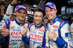 Pole winners Kazuki Nakajima celebrates with teammates Stéphane Sarrazin and Alexander Wurz
