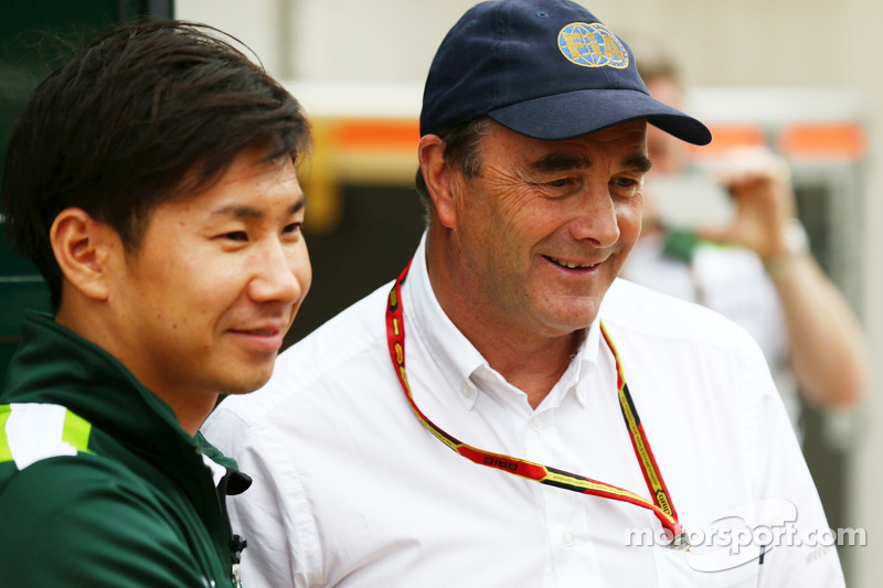 (L to R): Kamui Kobayashi, Caterham with Nigel Mansell, FIA Steward