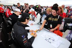Nico Hulkenberg, Sahara Force India F1 and team mate Sergio Perez, Sahara Force India F1 sign autographs for the fans