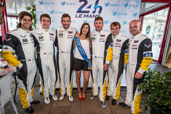Jordan Taylor Tommy Milner, Oliver Gavin, Richard Westbrook, Antonio Garcia and Jan Magnussen pose wih Miss 24 Hours of Le Mans