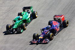Jean-Eric Vergne, Scuderia Toro Rosso STR9 passes Marcus Ericsson, Caterham CT05