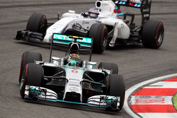 Nico Rosberg, Mercedes AMG F1 W05 leads Valtteri Bottas, Williams FW36