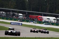 Kimi Raikkonen, Ferrari F14-T leads Fernando Alonso, Ferrari F14-T and Sebastian Vettel, Red Bull Racing RB10