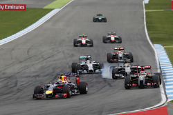 Daniel Ricciardo, Red Bull Racing RB10 leads Romain Grosjean, Lotus F1 E22 and Esteban Gutierrez, Sauber C33, who locks up under braking