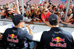 Sebastian Vettel, Red Bull Racing and team mate Daniel Ricciardo, Red Bull Racing sign autographs for the fans