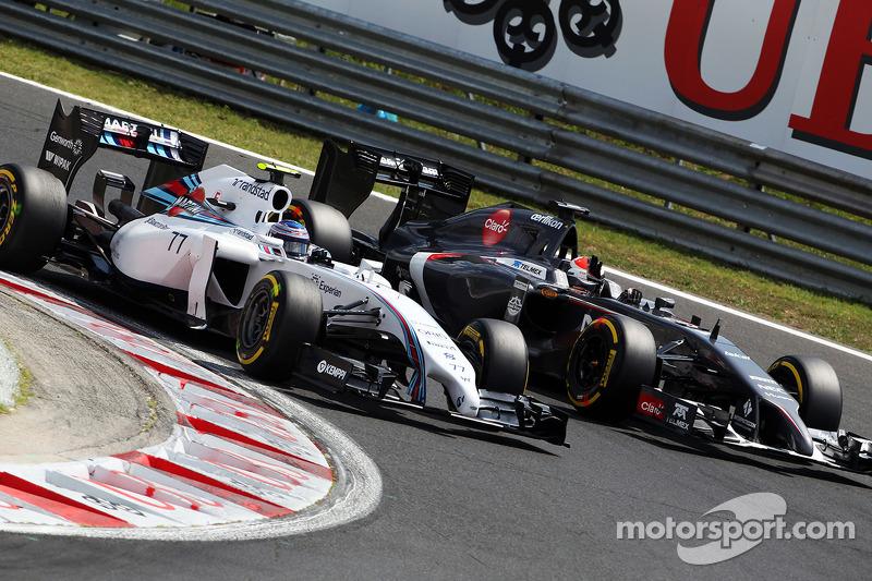 Valtteri Bottas, Williams FW36 and Adrian Sutil, Sauber C33