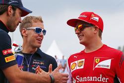 Jean-Eric Vergne, Scuderia Toro Rosso; Sebastian Vettel, Red Bull Racing; and Kimi Raikkonen, Ferrari on the drivers parade.