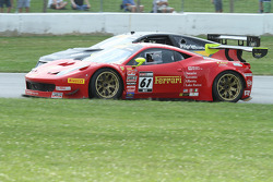 Anthony Lazzaro, Ferrari 458 GT3 and Andy Pilgrim, Cadillac CTS-V.R fight through turn 5