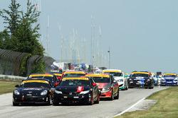 #04 Autometrics Motorsports Porsche Cayman: Adam Isman, Remo Ruscitti and #93 HART Honda Civic SI: Chad Gilsinger, Michael Valiante battle into the first turn of the race