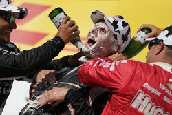 INDYCAR: Race winner Will Power gets a face full of cream puff and champagne bath from second place Juan Pablo Montoya and third place Tony Kanaan