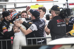 Race winner Dominik Baumann celebrates with his team