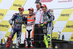 Podium: race winner Marc Marquez, second place Jorge Lorenzo, third place Valentino Rossi