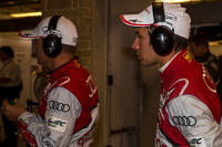 Loic Duval and Tom Kristensen carefully watch the #2 pit stop