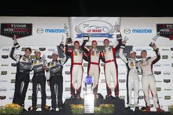GTD podium: winners Christopher Haase, Bryce Miller, Matt Bell, second place Madison Snow, Jan Heylen, third place John Potter, Andy Lally, Marco Seefried