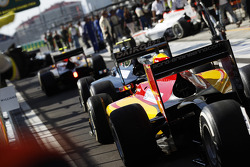 A queue forms in the pit lane