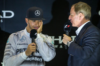 (L to R): race winner and World Champion Lewis Hamilton, Mercedes AMG F1 with Martin Brundle, Sky Sports Commentator on the podium
