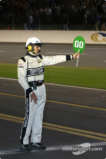 NASCAR official gives the go signal