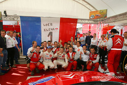2004 WRC champions Sébastien Loeb and Daniel Elena celebrate with Citroën Sport team members