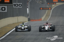 Takuma Sato passes Zsolt Baumgartner