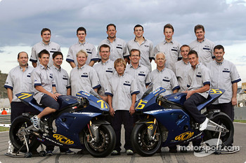 James Ellison and Chris Burns pose with the WCM team