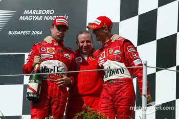 Podium: Rubens Barrichello, Jean Todt and Michael Schumacher celebrate