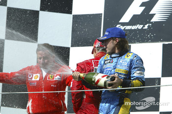 Podium: champagne for Jean Todt, Fernando Alonso and Michael Schumacher