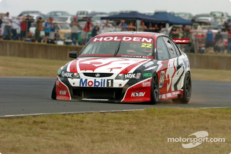 Todd Kelly suffered a puncture after tangling with team mate Mark Skaife at Turn 2