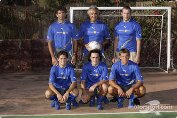 Giancarlo Fisichella, Flavio Briatore and Fernando Alonso play football