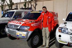Orlen Team Ralliart's Krzysztof Holowczyc with his Mitsubishi