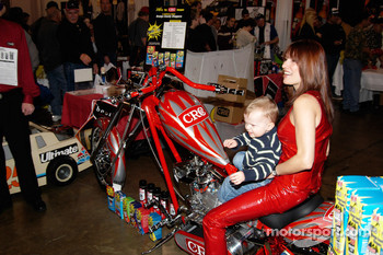 A young fan tries the CRC chopper on for size, just in case he wins it.