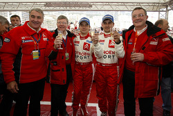 Sébastien Loeb and Daniel Elena celebrate with Guy Fréquelin, Jean-Claude Vaucard and Claude Satinet