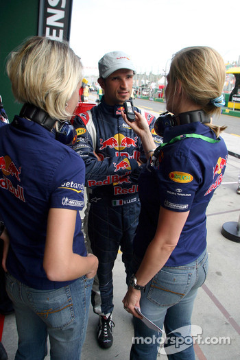 Vitantonio Liuzzi with Red Bull Racing press officers