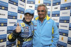 Pole winner Giancarlo Fisichella celebrates with Flavio Briatore