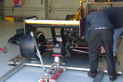 An Infiniti Pro Series car is readied for it's first road course test
