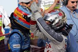 Race winner Fernando Alonso celebrates with Jarno Trulli