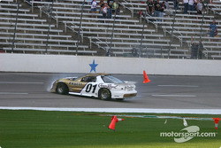 Scott Pruett slides down the front straight