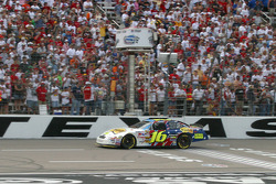 Greg Biffle takes the checkered flag