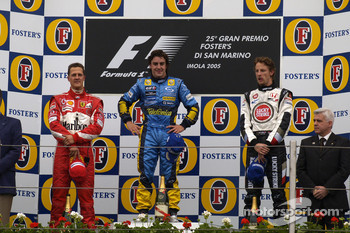 Podium: race winner Fernando Alonso with Michael Schumacher and Jenson Button