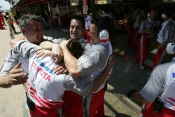 Toyota team members celebrates provisional pole position of Jarno Trulli