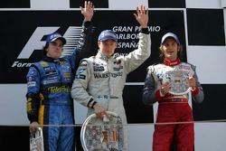 Podium: race winner Kimi Raikkonen with Fernando Alonso and Jarno Trulli